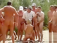 Swinger wife blows multiple strangers at the beach blowbang