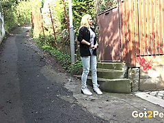 village blonde chick has nothing against peeing outdoors near the house