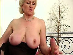 horn-mad wrinkled curly blonde mature bbw in black stuff exposes tits