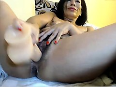 mature brunette mom in black rubbing her hairy cunt and toys