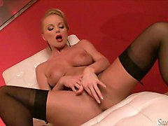Silvia Saint strips from her satin blouse and mini skirt